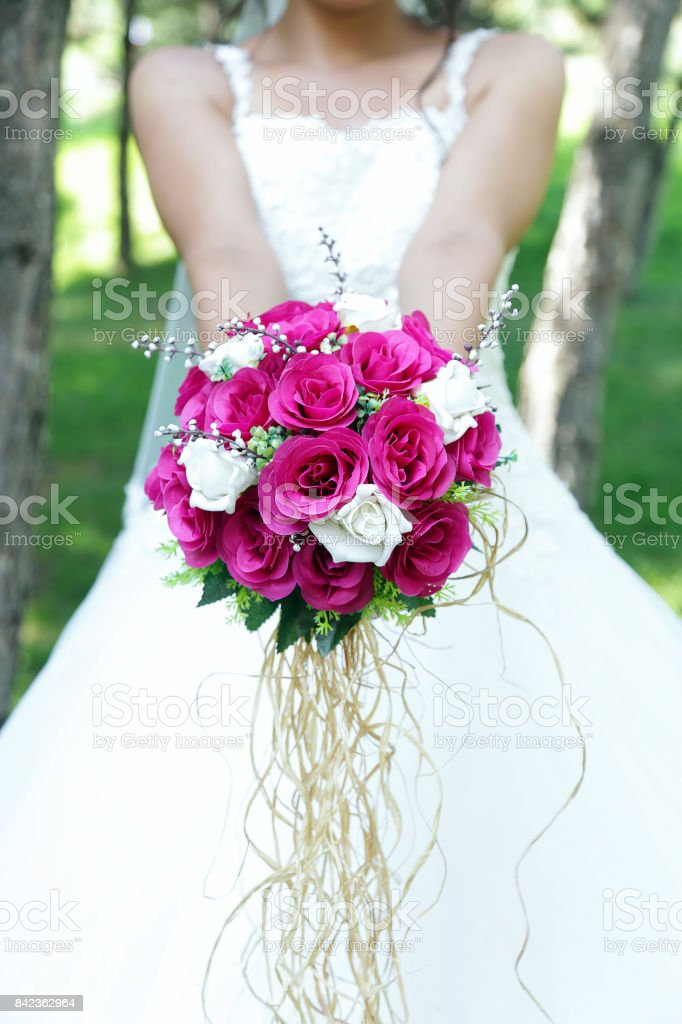 Bride Holding A Purple And White Wedding Bouquet Of Flowers Bride ...