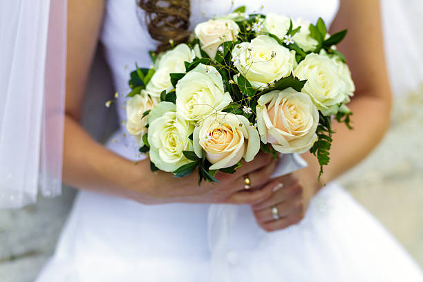Bride holding beautiful bouquet of roses stock photo