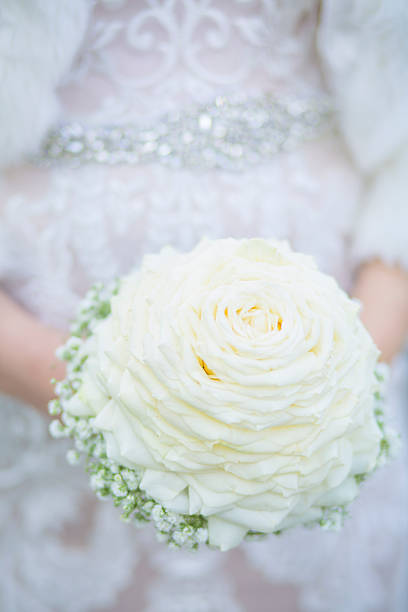 Bride holding Biedermeier Bouquet stock photo