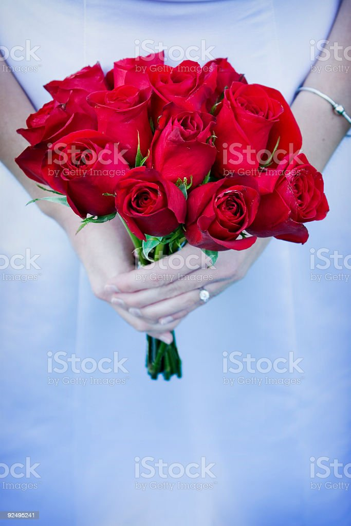 Bride holding bouguet of roses royalty-free stock photo