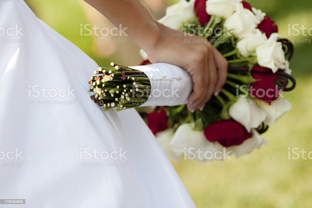 Bride holding Bouquet White and Red Roses on Wedding Day royalty-free stock photo