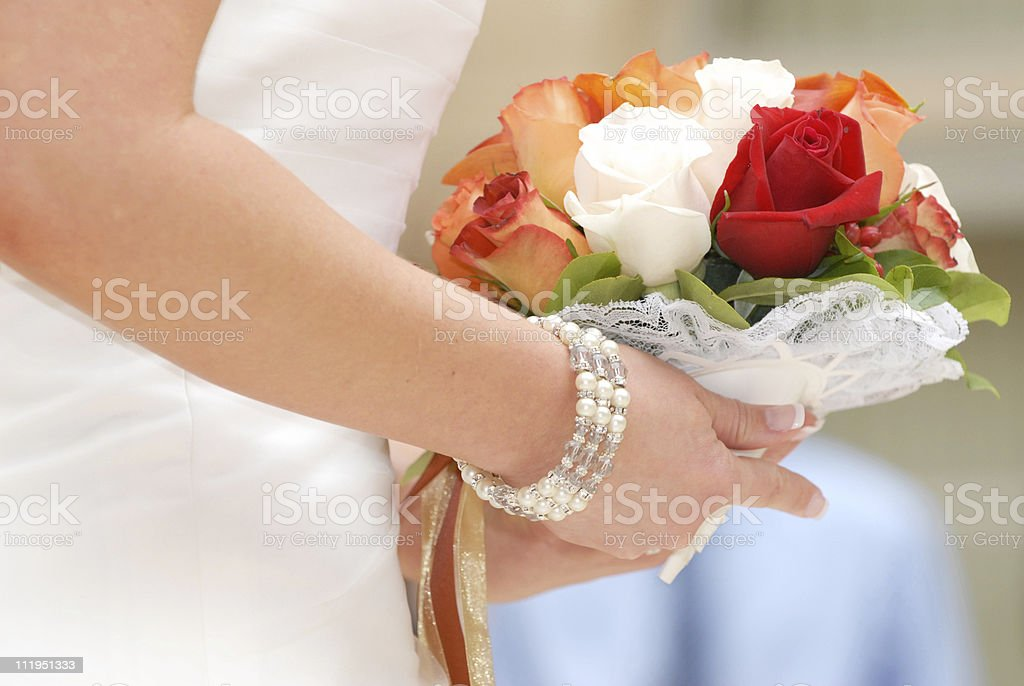Bride holding Bridal Bouquet at Wedding Ceremony royalty-free stock photo