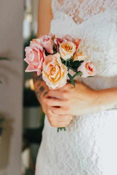 Bride holding flowers stock photo
