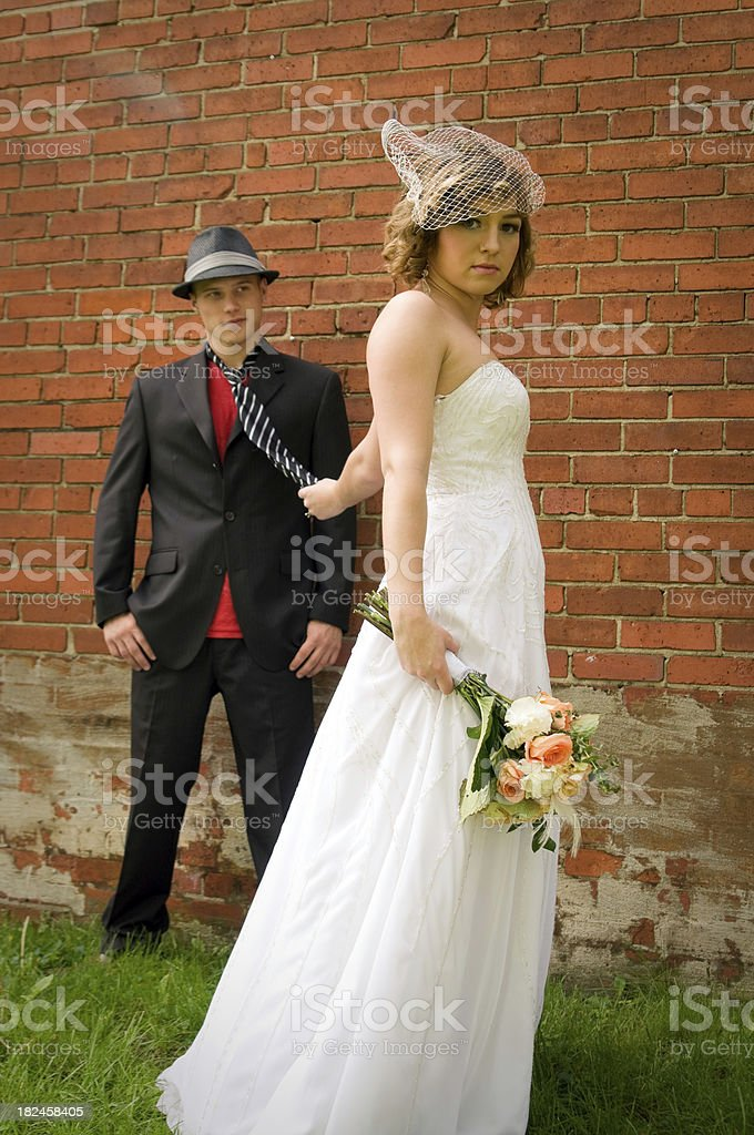 Bride holding grooms tie royalty-free stock photo