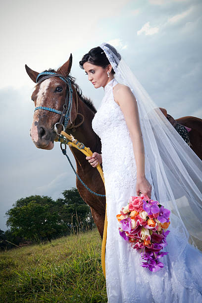 Bride Holding Horse in a Cloudy day at a Farm - foto de acervo