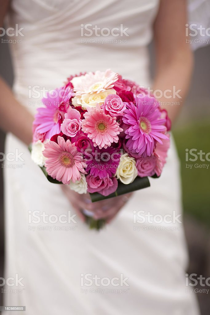 Bride holding pink bouquet royalty-free stock photo