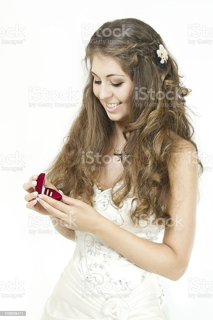 Bride holding red box with golden wedding rings royalty-free stock photo