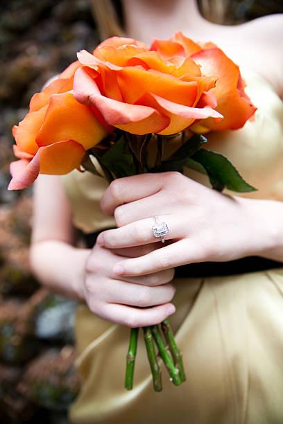 Bride Holding Rose Bouquet stock photo