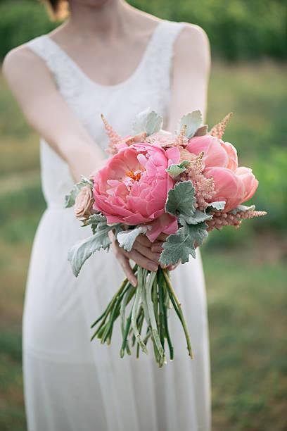 Bride holding wedding bouquet stock photo