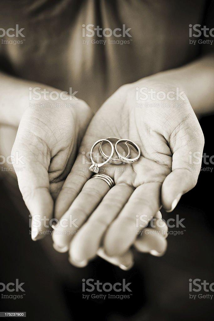 Bride Holding Wedding Engagement Rings Symbol of Love royalty-free stock photo