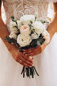 istock Bride holding wedding peonies bouquet 1198116238