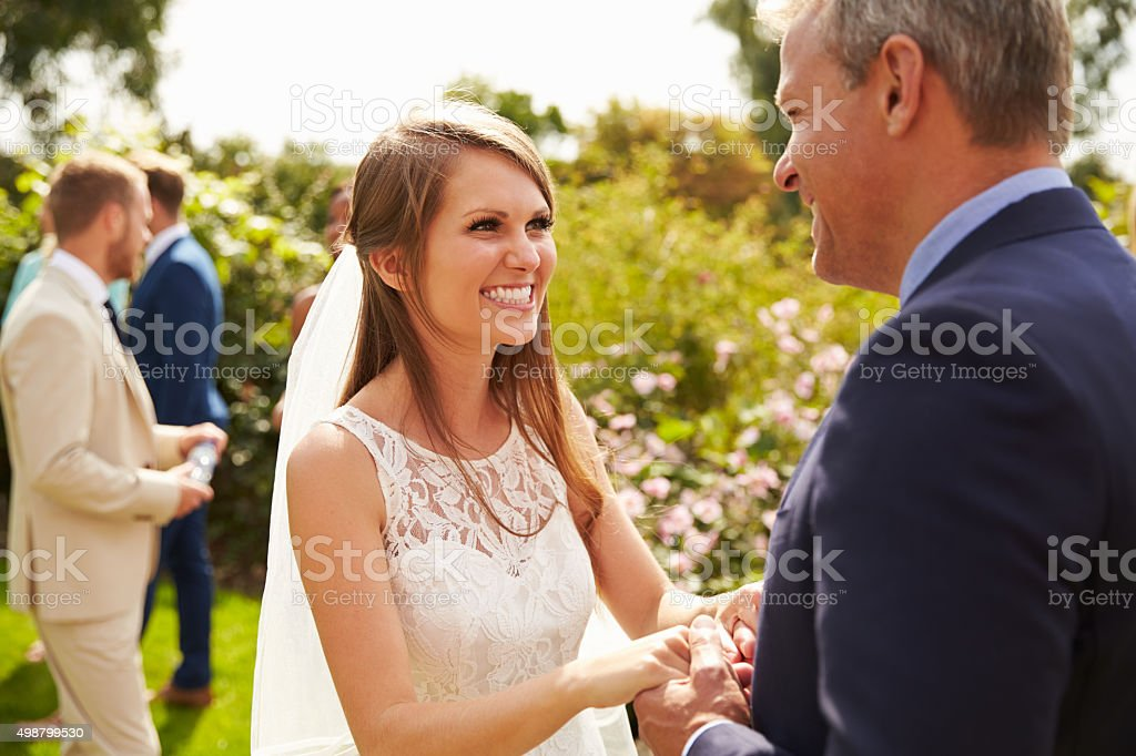 Bride Hugging Father On Wedding Day stock photo