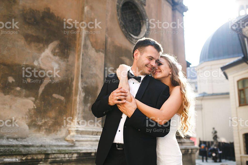 Bride hugging groom stock photo