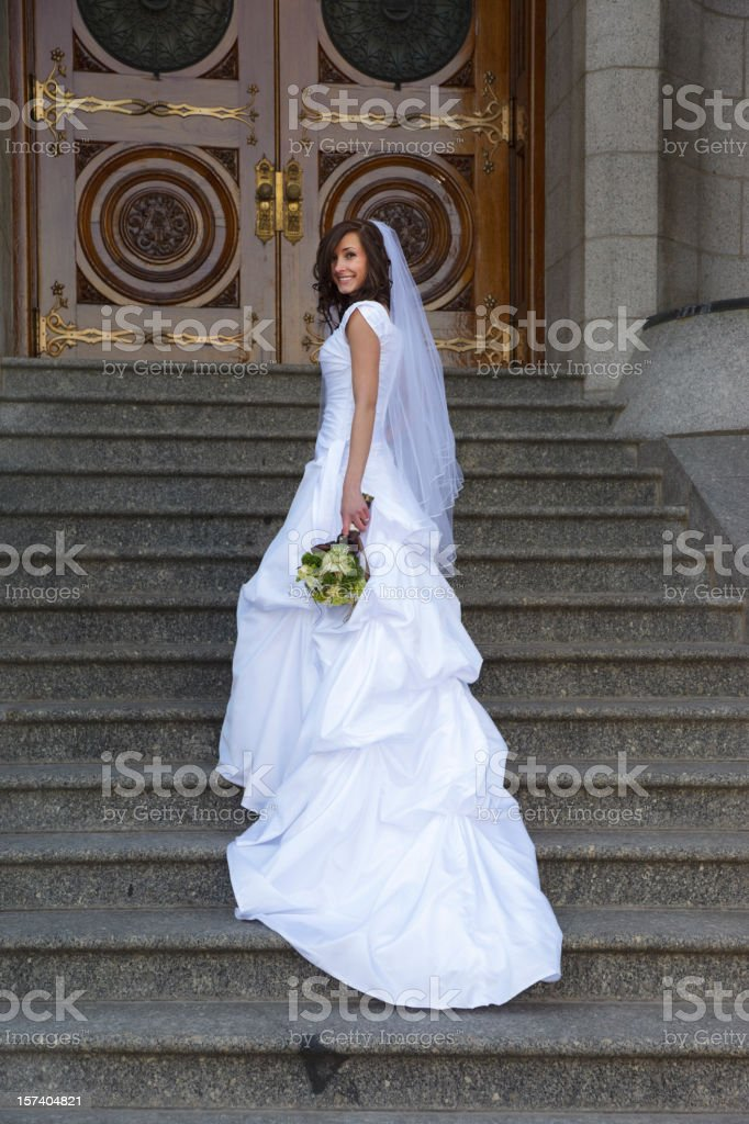 Bride in Front of Church royalty-free stock photo