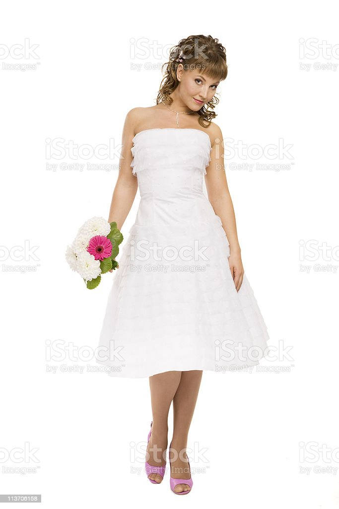 Bride in pink shoes stock photo