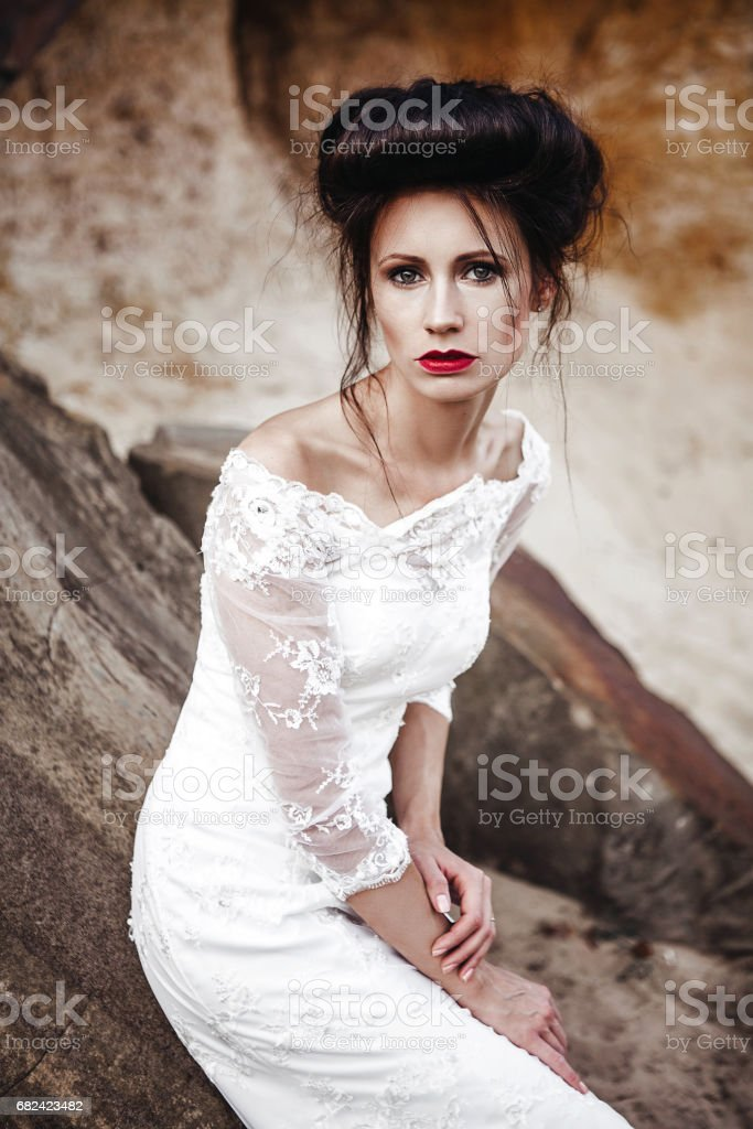 bride in wedding dress  in desert with rocks and stones royalty-free stock photo