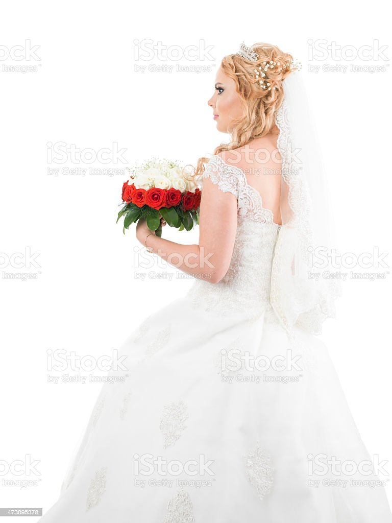 Bride In Wedding Dress Posing With Bouquet Toss On White Stock