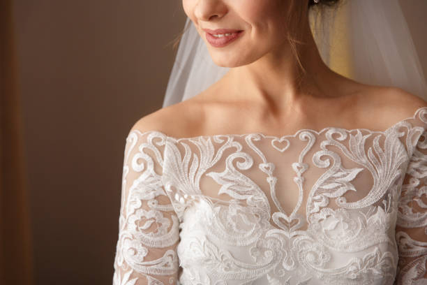Bride in white wedding dress with lace, embroidery. Bride getting ready stock photo