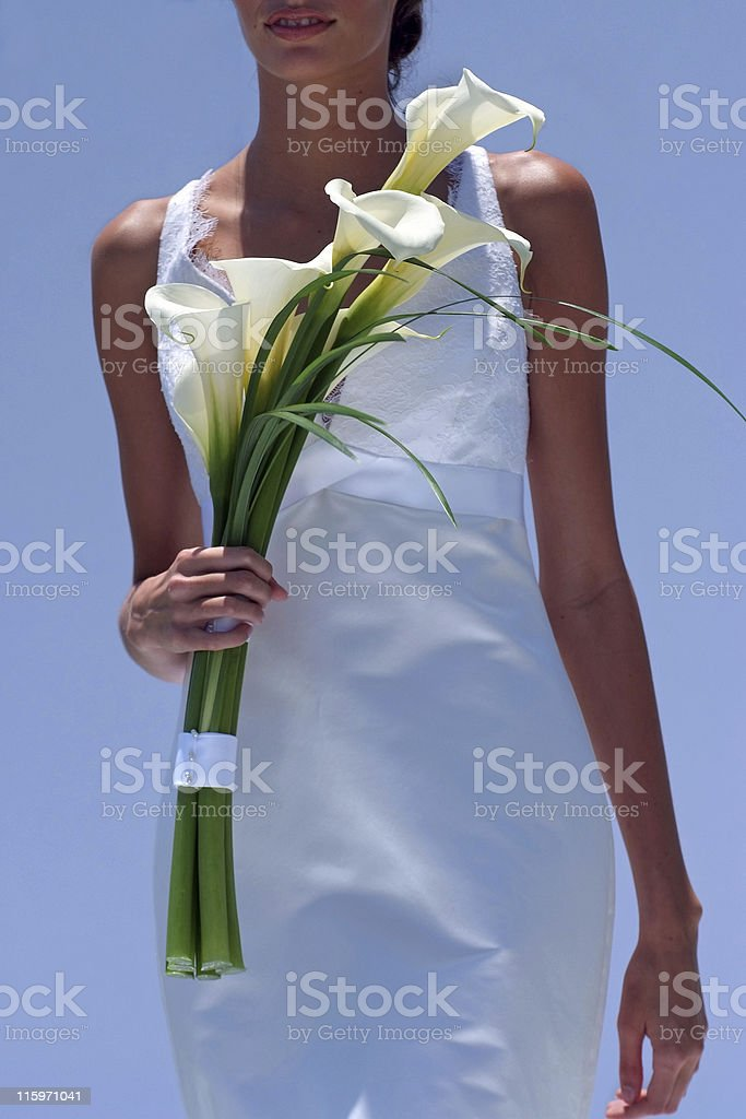 Bride in white with lilies against blue sky royalty-free stock photo