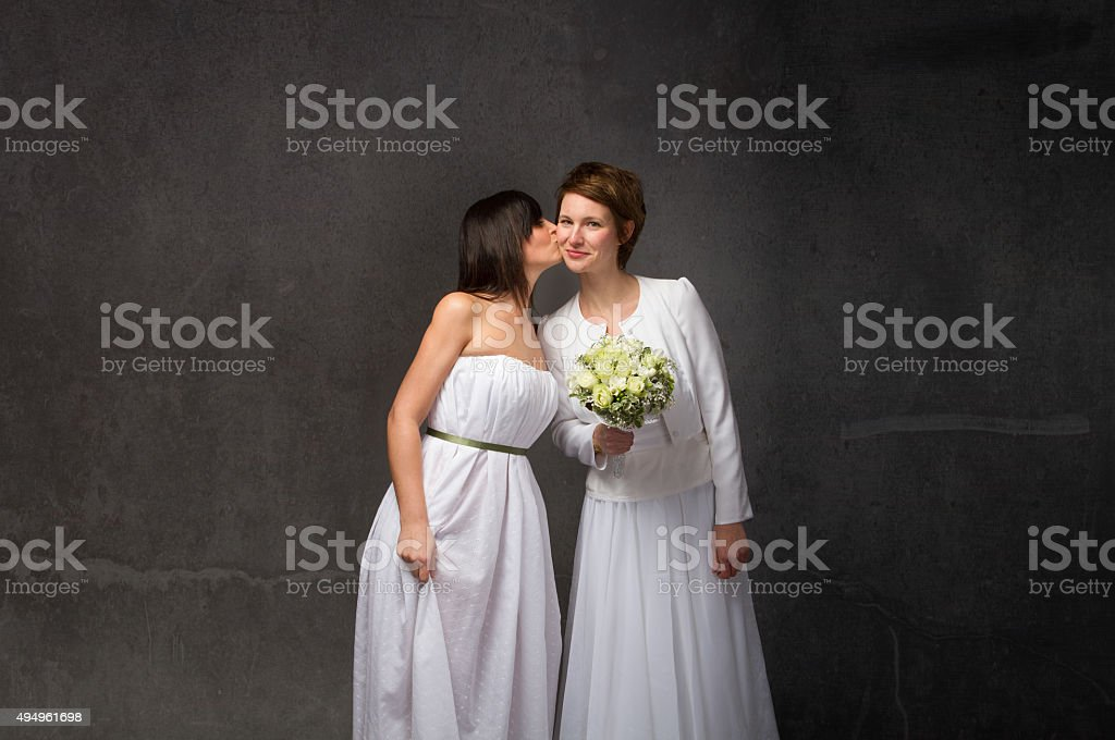 bride kissing stock photo