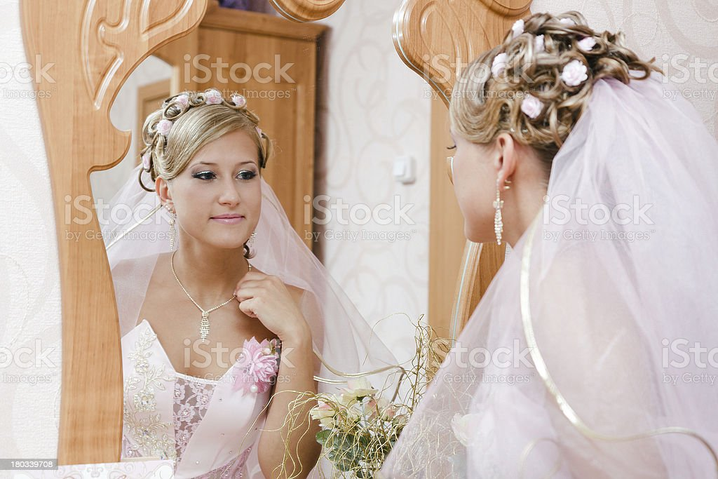 bride looks in the mirror royalty-free stock photo