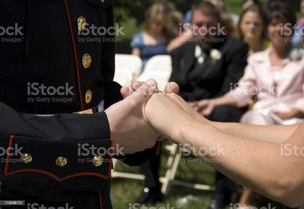 Bride & Marine Groom Holding Hands royalty-free stock photo