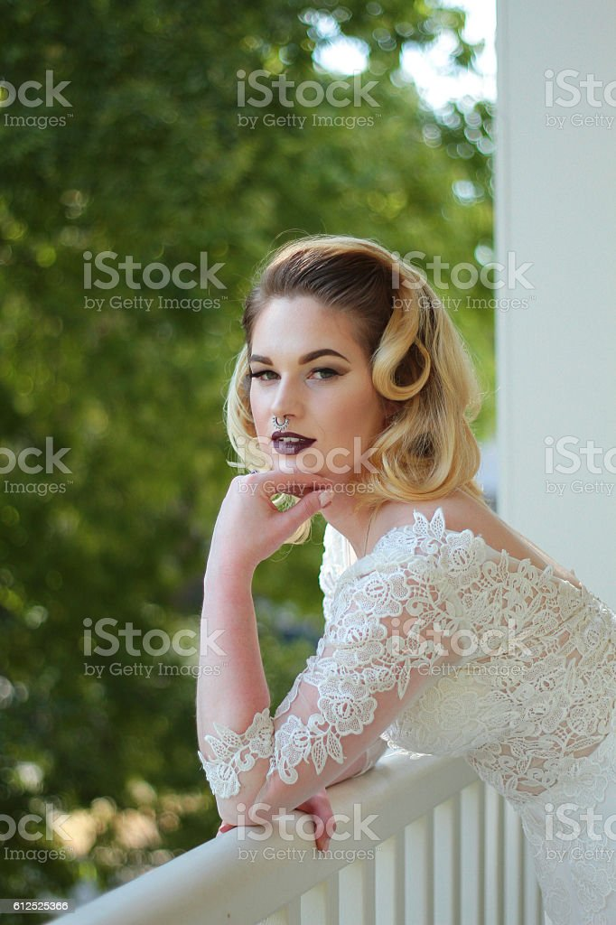 Bride on Balcony stock photo
