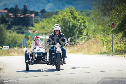Bride on Her Way To Wedding Ceremony in an Old Sidecar Motorcycle.
