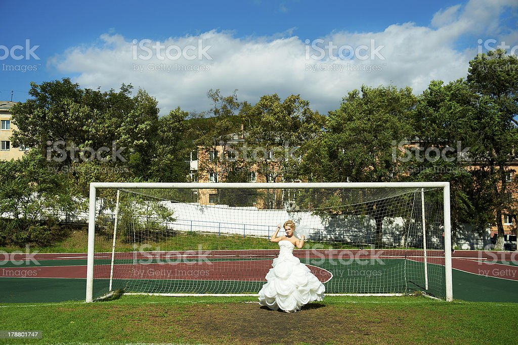 Bride on the football field royalty-free stock photo