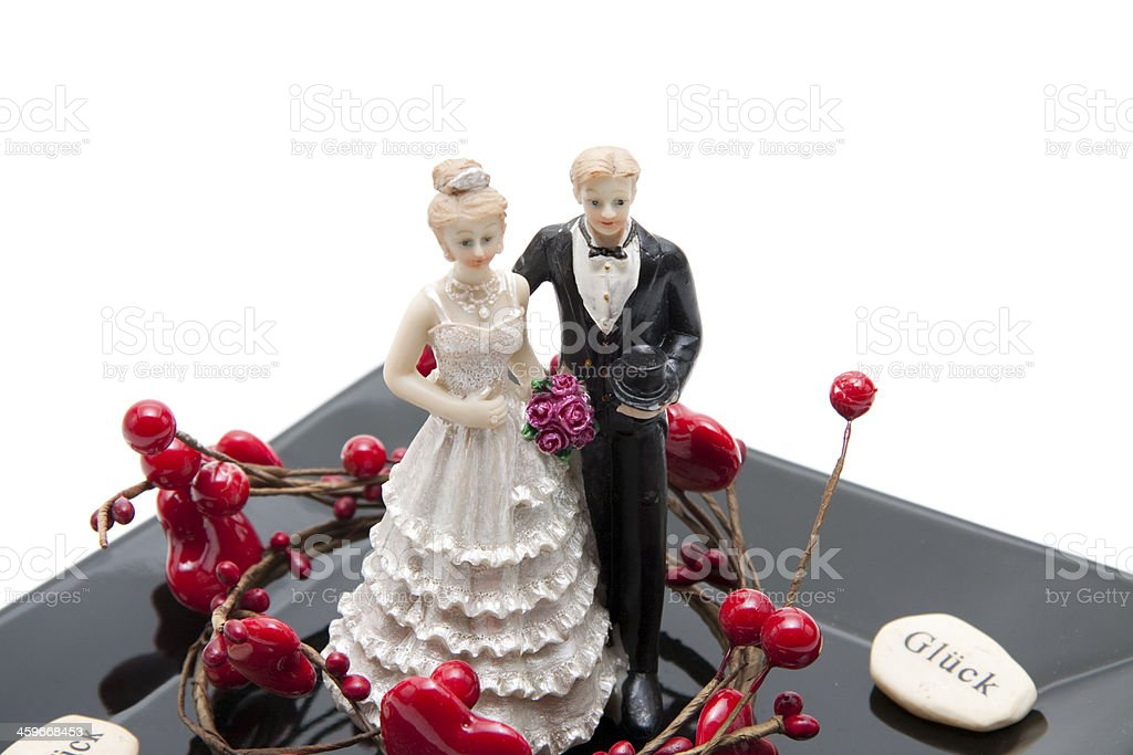 Bride pair with heart on black plate stock photo