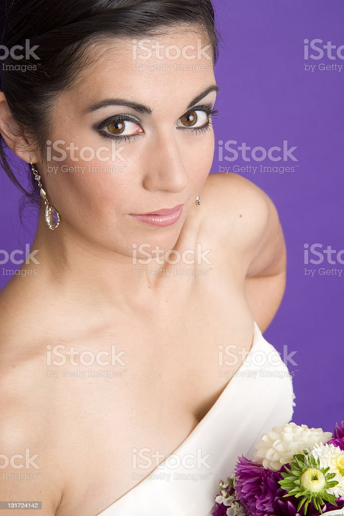 Bride Perfect Collar Bones Floral Bouquet Looks up at Camera royalty-free stock photo