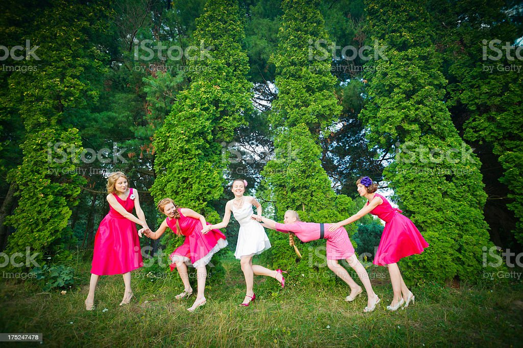 Bride playing with her best friends royalty-free stock photo
