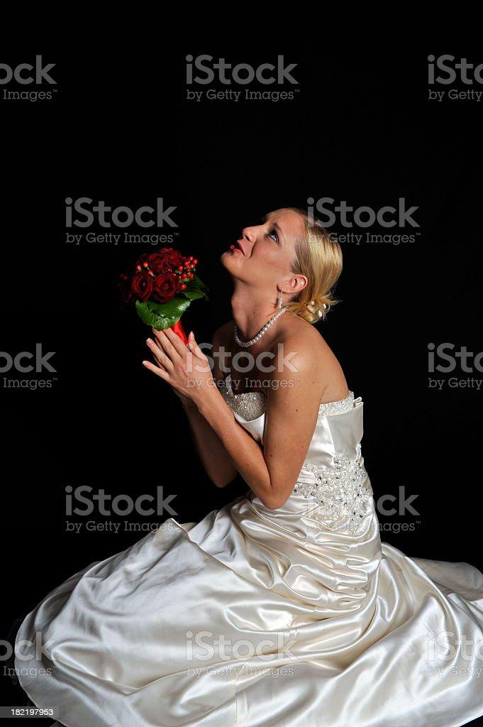 Bride praying royalty-free stock photo