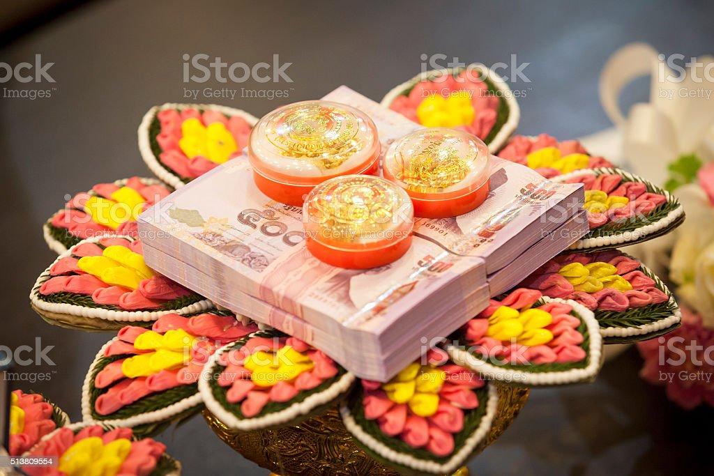 Bride price money and gold in traditional wedding ceremony. stock photo