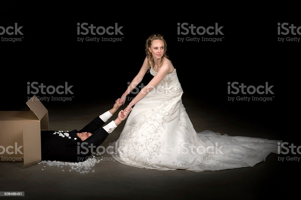 Bride receiving a brand new husband stock photo