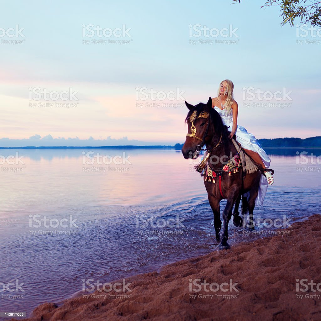 Bride riding a horse royalty-free stock photo