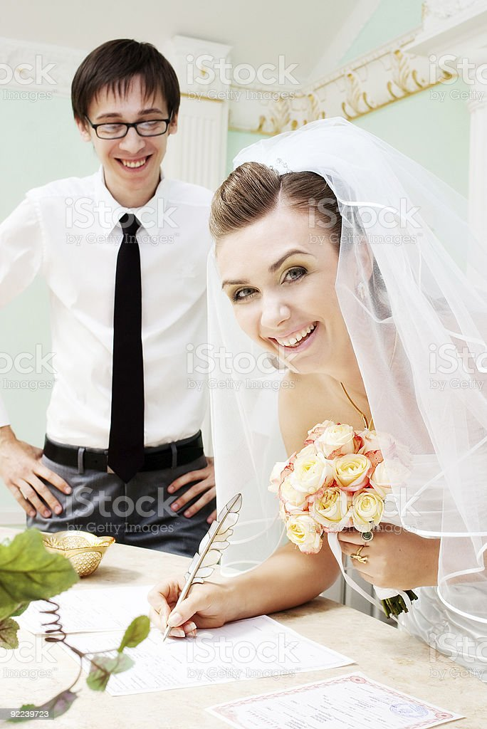 bride signing marriage papers royalty-free stock photo