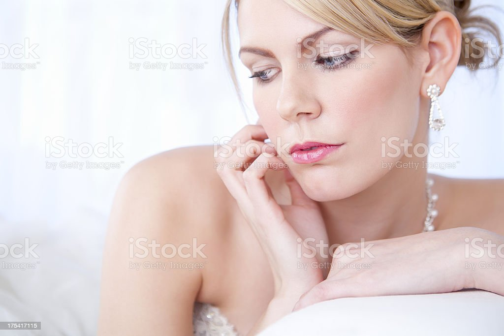 Bride sitting on sofa royalty-free stock photo