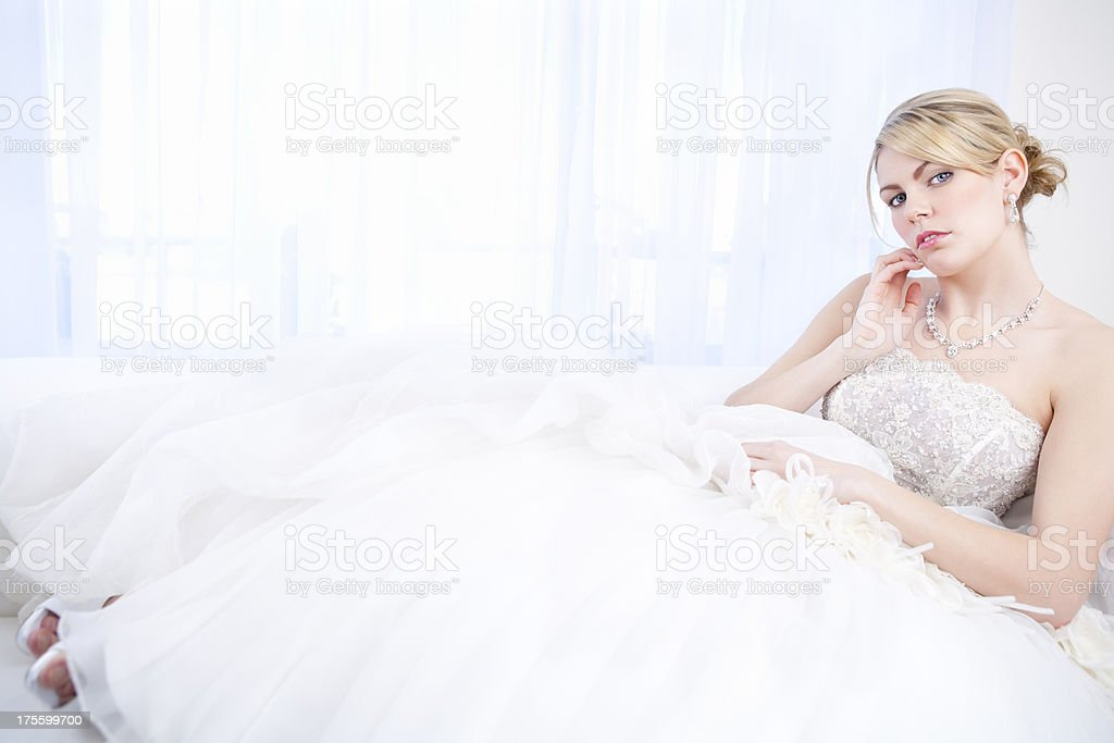 Bride sitting on sofa royalty-free stock photo