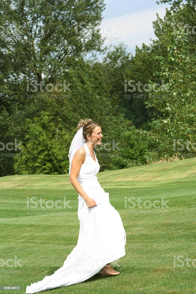 Bride Smiling and Walking Barefoot royalty-free stock photo