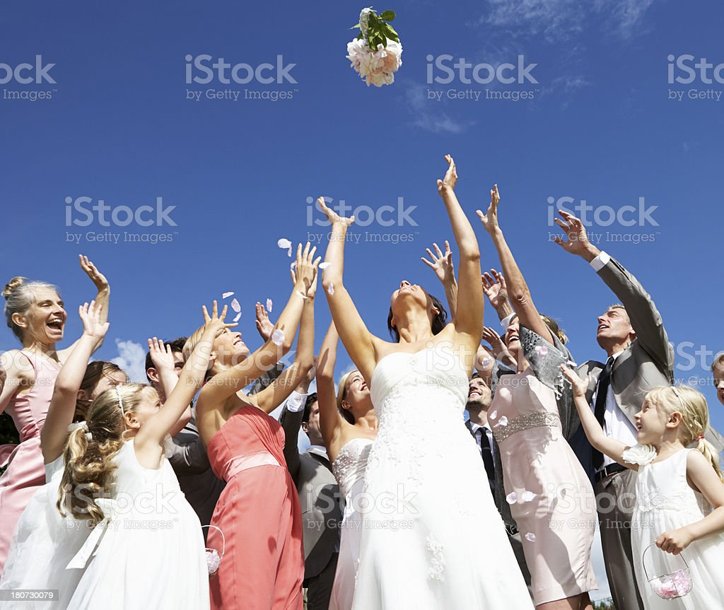 Bride Throwing Bouquet For Guests To Catch stock photo