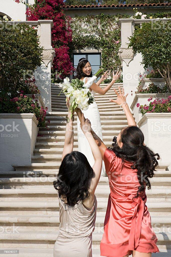 Bride throwing bouquet 免版稅 stock photo
