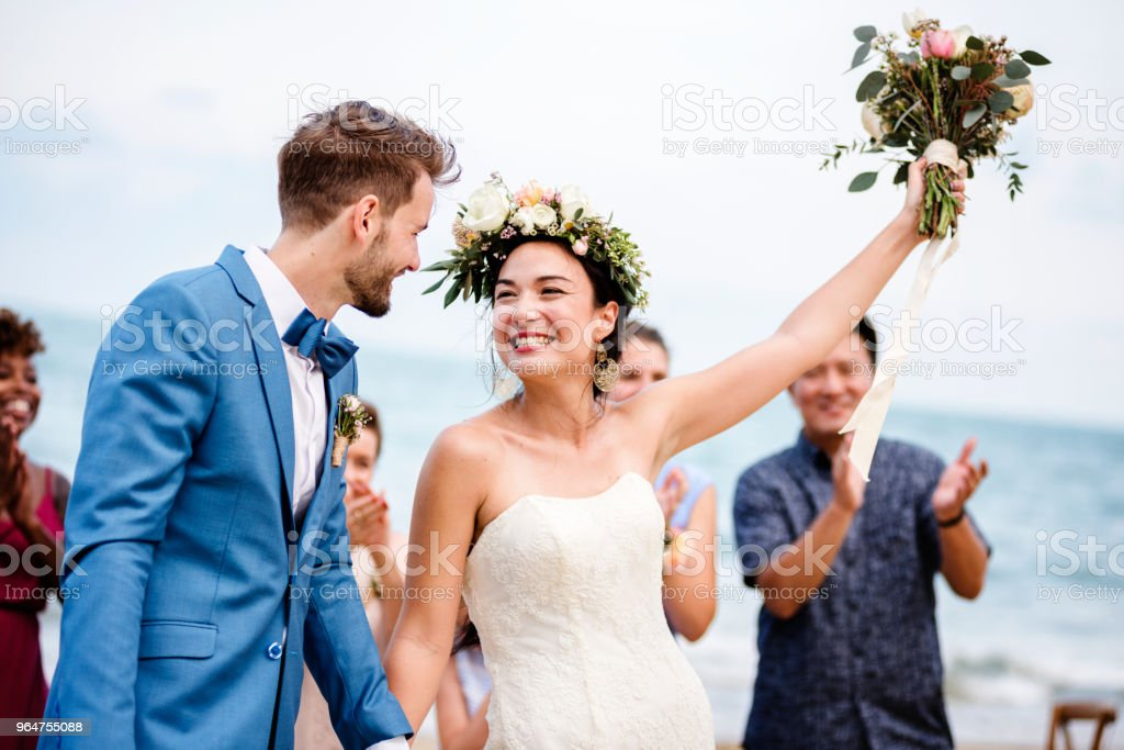 Bride throwing flower bouquet to guests royalty-free stock photo