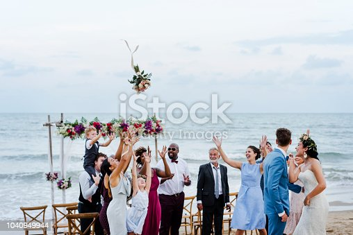 Bride throwing the bouquet at wedding