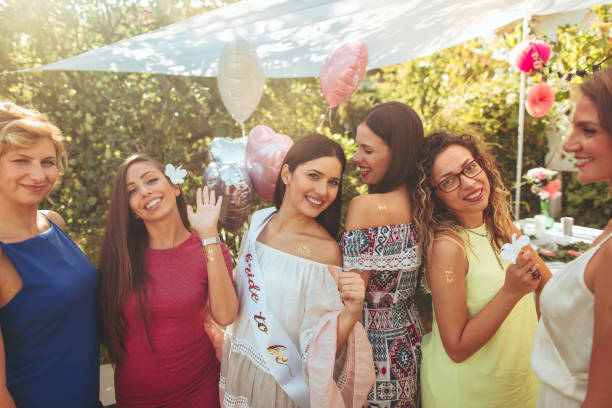 Bride to be and bride tribe at bachelorette party stock photo