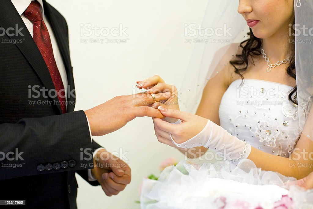 Bride to groom puts ring royalty-free stock photo