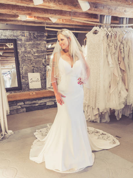 bride trying on dress at rustic bridal shop - katiedobies stock pictures, royalty-free photos & images