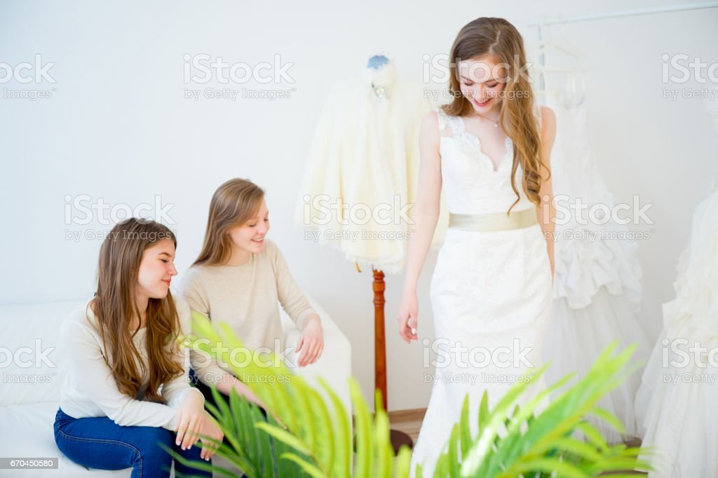 Bride trying on wedding dress stock photo