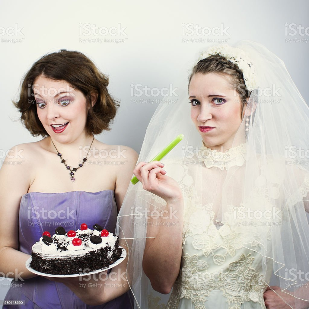 Bride trying to diet and eating celery stock photo