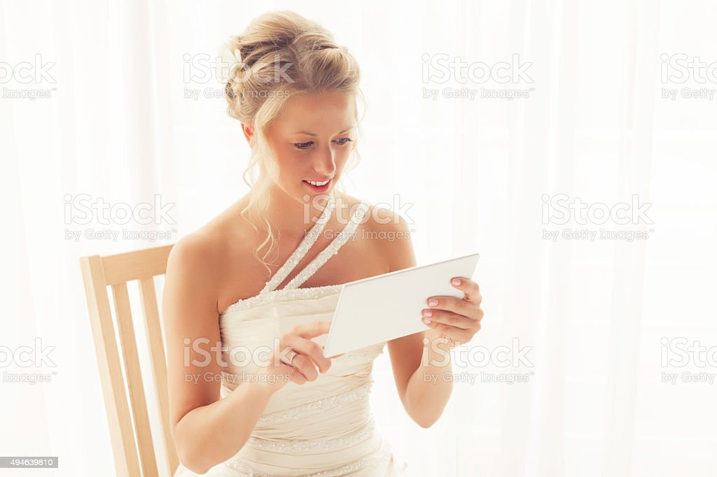 Bride using tablet stock photo